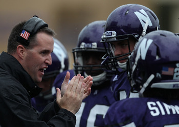 EVANSTON, IL - OCTOBER 23: Head coach Pat Fitzgerald of the Northwestern Wildcats encourages his team as they take on the Michigan State Spartans at Ryan Field on October 23, 2010 in Evanston, Illinois. Michigan State defeated Northwestern 35-27.  (Photo