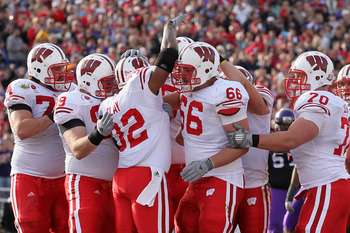 PASADENA, CA - JANUARY 01:  Running back John Clay #32 of the Wisconsin Badgers celebrates with teammates after scoring a touchdown in the first quarter against the TCU Horned Frogs during the 97th Rose Bowl game on January 1, 2011 in Pasadena, California