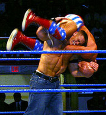 "That is John Cena giving Kurt Angle an ""Attitude Ajustment"""