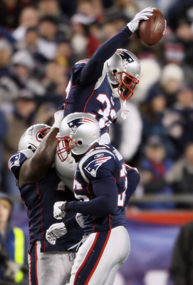 FOXBORO, MA - NOVEMBER 21:   Devin McCourty #32 of the New England Patriots celebrates with teammates Kyle Love #74 and James Sanders #36 after McCourty intercepted a pass from the Indianapolis Colts on November 21, 2010 at Gillette Stadium in Foxboro, Ma