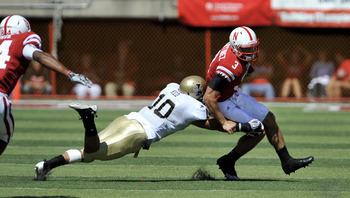 LINCOLN, NE - SEPTEMBER 11: Nebraska Cornhuskers quarterback Taylor Martinez #3 runs from Idaho Vandals safety Shiloh Keo #10 and Idaho Vandals cornerback Kenneth Patten #2 during second half action of their game at Memorial Stadium on September 4, 2010 i