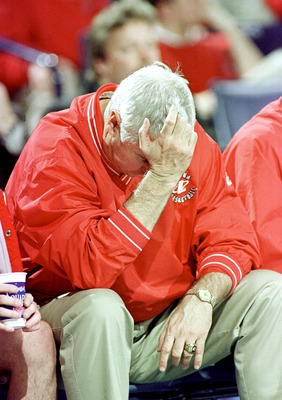 N366226 02: (NORTH AND SOUTH AMERICA SALES ONLY) FILE PHOTO: Indiana Coach Bobby Knight holds his head during a NCAA East Regional game March 17, 2000 in Buffalo, NY. After three decades, Knight's explosive temper may have engulfed his career as the contr