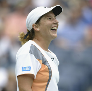 FLUSHING, NY - AUGUST 31:  Monica Seles of the USA celebrates while playing Yoon Jeong Cho of Korea during the US Open at the USTA National Tennis Center on August 31, 2002 in Flushing Meadows-Corona Park, New York.  (Photo by Gary M. Prior/Getty Images)