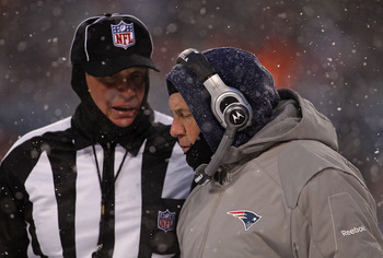 CHICAGO, IL - DECEMBER 12: Head coach Bill Belichick of the New England Patriots talks with a referee during a game against the Chicago Bears at Soldier Field on December 12, 2010 in Chicago, Illinois. The Patriots defeated the Bears 36-7. (Photo by Jonat