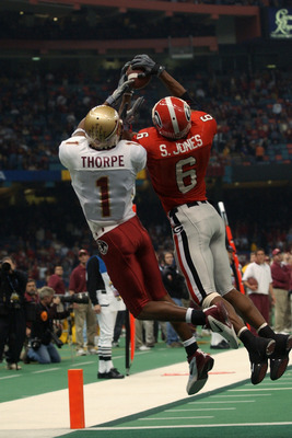 NEW ORLEANS - JANUARY 1:  Wide receiver Craphonso Thorpe #1 of the Florida State University Seminoles and free safety Sean Jones #6 of the University of Georgia Bulldogs attempt to catch a pass during the Nokia Sugar Bowl game at the Louisiana Superdome o