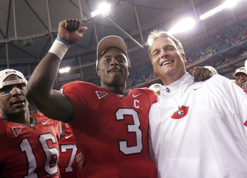 ATLANTA - DECEMBER 3:  Quarterback D.J. Shockley #3 and coach Mark Richt of the Georgia Bulldogs celebrate after a 34-14 win over the Louisiana State University Tigers during the 2005 SEC Football Championship Game on December 3, 2005 at the Georgia Dome