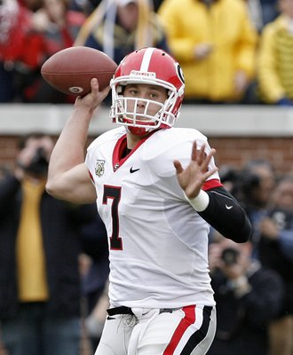 ATLANTA - NOVEMBER 24: Quarterback Matthew Stafford #7 of the Georgia Bulldogs throws a screen pass during the game against the Georgia Tech Yellow Jackets on November 24, 2007 at Bobby Dodd Stadium at Historic Grant Field in Atlanta, Georgia.  Georgia de