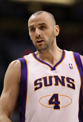 PHOENIX - DECEMBER 23:  Marcin Gortat #4 of the Phoenix Suns during the NBA game against the Miami Heat at US Airways Center on December 23, 2010 in Phoenix, Arizona.  The Heat defeated the Suns 95-83.  NOTE TO USER: User expressly acknowledges and agrees