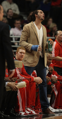 CHICAGO, IL - DECEMBER 21: Injured player Joakim Noah of the Chicago Bulls yells his displeasure at a call during a game against the Philadelphia 76ers at the United Center on December 21, 2010 in Chicago, Illinois. The Bulls defeated the 76ers 121-76. NO
