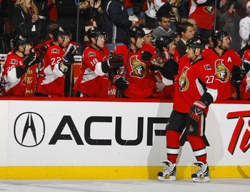 OTTAWA, ON - NOVEMBER 22:  Alex Kovalev #27 of the Ottawa Senators celebrates his goal and his 1000th NHL regular season point with his teammates on the bench during a game against the Los Angeles Kings at Scotiabank Place on November 22, 2010 in Ottawa,