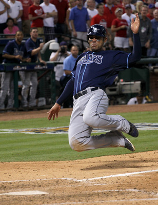 ARLINGTON, TX - OCTOBER 9: Carlos Pena #23 of the Tampa Bay Rays slides home with a run in the eighth inning against the Texas Rangers during game three of the ALDS at Rangers Ballpark in Arlington on October 9, 2010 in Arlington, Texas.  The Rays won 6-3