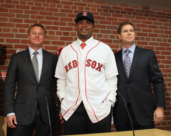 BOSTON, MA - DECEMBER 11:  Carl Crawford poses with his agents during a press conference announcing his signing with the Boston Red Sox on December 11,  2010 at the Fenway Park in Boston, Massachusetts.  (Photo by Elsa/Getty Images)