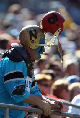 CHARLOTTE, NC - OCTOBER 24:  A fan wears a helmet to helmet hat due to the recent concerns in the NFL involving bad tackles during the San Francisco 49ers versus Carolina Panthers during their game at Bank of America Stadium on October 24, 2010 in Charlot