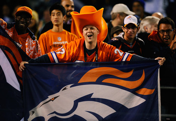 SAN DIEGO - NOVEMBER 22:  A Denver Bronco fan cheers during the NFL football game against  San Diego Chargers at Qualcomm Stadium on November 22, 2010 in San Diego, California.  (Photo by Kevork Djansezian/Getty Images)