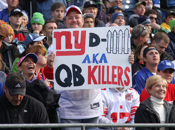SEATTLE - NOVEMBER 07:  A fan of the New York Giants holds a sign during the game against the Seattle Seahawks at Qwest Field on November 7, 2010 in Seattle, Washington. The Giants defeated the Seahawks 41-7. (Photo by Otto Greule Jr/Getty Images)