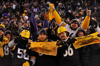 BALTIMORE, MD - DECEMBER 05:  Fans of the the Pittsburgh Steelers cheer during the game against the Baltimore Ravens at M&T Bank Stadium on December 5, 2010 in Baltimore, Maryland. Pittsburgh won 13-10.  (Photo by Larry French/Getty Images)