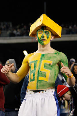 FOXBORO, MA - DECEMBER 19:  A fan of the Green Bay Packers cheers for the team prior to the start of the game against New England Patriots at Gillette Stadium on December 19, 2010 in Foxboro, Massachusetts.  (Photo by Jim Rogash/Getty Images)