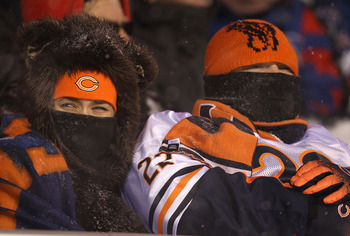 CHICAGO - DECEMBER 12: Fans of the Chicago Bears try to stay warm as they watch the Bears take on the New England Patriots at Soldier Field on December 12, 2010 in Chicago, Illinois. The Patriots defeated the Bears 36-7. (Photo by Jonathan Daniel/Getty Im
