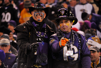 BALTIMORE, MD - DECEMBER 05:  Fans of the Baltimore Ravens smile for a photo during the second quarter of the game against the Pittsburgh Steelers at M&T Bank Stadium on December 5, 2010 in Baltimore, Maryland.  (Photo by Larry French/Getty Images)