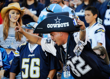 SAN DIEGO - AUGUST 21:  Fans of Dallas Cowboys cheer during the pre-season NFL football game against San Diego Chargers at Qualcomm Stadium on August 21, 2010 in San Diego, California.  (Photo by Kevork Djansezian/Getty Images)