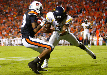 AUBURN, AL - SEPTEMBER 19:  Darvin Adams #89 of the Auburn Tigers scores a touchdown as he gets tackled by Robert Sands #2 of the West Virginia Mountaineers at Jordan-Hare Stadium on September 19, 2009 in Auburn, Alabama.  (Photo by Kevin C. Cox/Getty Ima