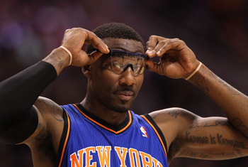PHOENIX - JANUARY 07:  Amar'e Stoudemire #1 of the New York Knicks adjusts his glasses during the NBA game against the Phoenix Suns at US Airways Center on January 7, 2011 in Phoenix, Arizona.  NOTE TO USER: User expressly acknowledges and agrees that, by
