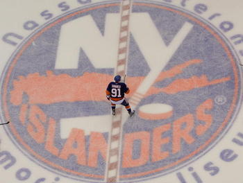 UNIONDALE, NY - OCTOBER 03:  John Tavares #91 of the New York Islanders skates over the on ice logo during the Islanders home season opener against the Pittsburgh Penguins at an NHL hockey game at the Nassau Coliseum on October 3, 2009 in Uniondale, New Y