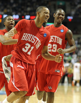 SPOKANE - MARCH 19:  Adam Brown #31 of the Houston Cougars celebrates after hitting a three-point shot with time expiring in the first half against the Maryland Terrapins in the first round of the 2010 NCAA men's basketball tournament at the Spokane Arena