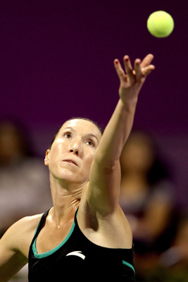 DOHA, QATAR - OCTOBER 29:  Jelena Jankovic of Serbia serves to Victoria Azarenka of Belarus during day four of the WTA Championships at the Khalifa Tennis Complex on October 29, 2010 in Doha, Qatar.  (Photo by Matthew Stockman/Getty Images)