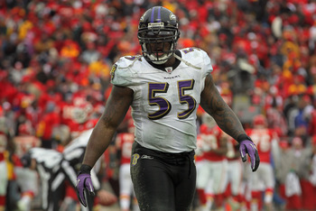 KANSAS CITY, MO - JANUARY 09:  Linebacker Terrell Suggs #55 of the Baltimore Ravens pauses during a break in the action against the Kansas City Chiefs during their 2011 AFC wild card playoff game at Arrowhead Stadium on January 9, 2011 in Kansas City, Mis