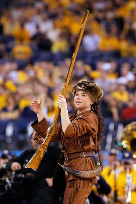 INDIANAPOLIS - APRIL 03:  Rebecca Durst, mascot for of the West Virginia Mountaineers performs during a break in the game while taking on the Duke Blue Devils during the National Semifinal game of the 2010 NCAA Division I Men's Basketball Championship at