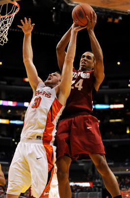 LOS ANGELES, CA - MARCH 11:  Forward Daniel Deane #30 of the Oregon State Beavers and center Josh Owens #24 of the Stanford Cardinal go up for a rebound during the Pacific Life Pac-10 Men's Basketball Tournament at the Staples Center on March 11, 2009 in