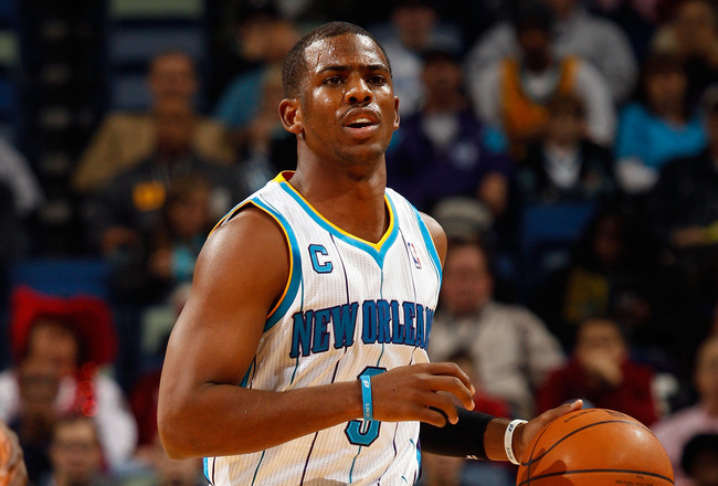 NEW ORLEANS, LA - JANUARY 03:  Chris Paul #3 of the New Orleans Hornets moves the ball in the first half against the Philadelphia 76ers at New Orleans Arena on January 3, 2011 in New Orleans, Louisiana. NOTE TO USER: User expressly acknowledges and agrees