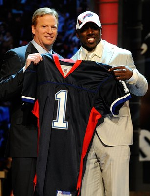 NEW YORK - APRIL 22:  C.J. Spiller from the Clemson Tigers poses with NFL Commissioner Roger Goodell as they hold up a Buffalo Bills jersey after Spiller was selected number 9 overall by the Bills during the first round of the 2010 NFL Draft at Radio City
