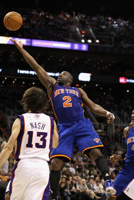 PHOENIX - JANUARY 07:  Raymond Felton #2 of the New York Knicks lays up a shot over Steve Nash #13 of the Phoenix Suns during the NBA game at US Airways Center on January 7, 2011 in Phoenix, Arizona.   The Knicks defeated the Suns 121-96.  NOTE TO USER: U