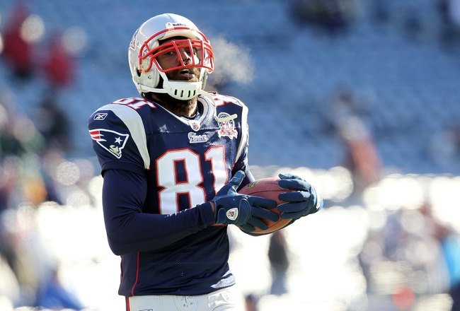 FOXBORO, MA - JANUARY 10:  Randy Moss #81 of the New England Patriots looks on during warm ups against the Baltimore Ravens during the 2010 AFC wild-card playoff game at Gillette Stadium on January 10, 2010 in Foxboro, Massachusetts.  (Photo by Jim Rogash
