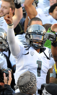 CORVALLIS, OR - DECEMBER 4: Quarterback Darron Thomas #1 of the Oregon Ducks signals to the fans in the stands after the game at Reser Stadium on December 4, 2010 in Corvallis, Oregon. he Ducks beat the Beavers 37-20 to likely go on the BCS Championship g