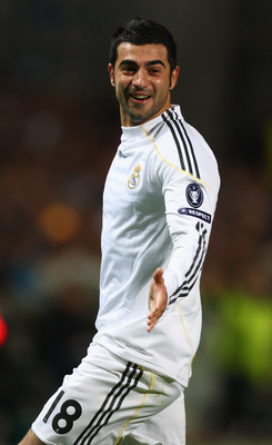 MARSEILLE, FRANCE - DECEMBER 08:  Raul Albiol of Real celebrates scoring his sides second goal during the Marseille v Real Madrid UEFA Champions League Group C match at the Stade Velodrome on December 8, 2009 in Marseille, France.  (Photo by Michael Steel
