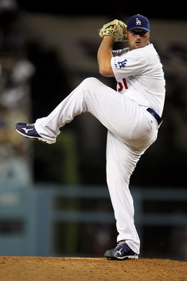 LOS ANGELES, CA - JUNE 04:  Jonathan Broxton #51 of the Los Angeles Dodgers pitches against the Atlanta Braves in the game at Dodger Stadium on June 4, 2010 in Los Angeles, California.  (Photo by Jeff Gross/Getty Images)