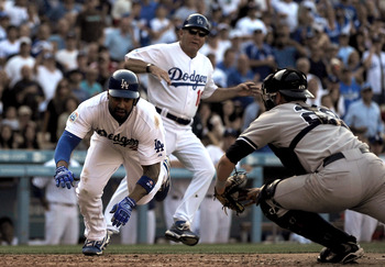 LOS ANGELES, CA - JUNE 26:  Matt Kemp #27 of the Los Angeles Dodgers is out at home plate in the fourth inning against Fancisco Cervelli #29 of the New York Yankees at Dodger Stadium on June 26, 2010 in Los Angeles, California.  (Photo by Lisa Blumenfeld/