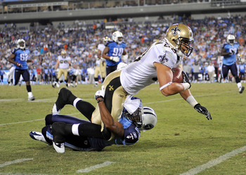 NASHVILLE, TN - SEPTEMBER 02:  Tye Hill #22  of the Tennessee Titans tackles Jimmy Graham #80 of the New Orleans Saints during an exhibition game at LP Field on September 2, 2010 in Nashville, Tennessee. Tennessee won 27-24.  (Photo by Grant Halverson/Get