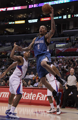 LOS ANGELES, CA - DECEMBER 20:  Michael Beasley #8 of the Minnesota Timberwolves drives to the basket past Ryan Gomes #15 of the Los Angeles Clippers during the first half at Staples Center on December 20, 2010 in Los Angeles, California. NOTE TO USER: Us