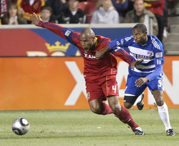 SANDY, UT - NOVEMBER 6: Jamison Olave #4 of Real Salt Lake and Jeff Cunningham #9 of FC Dallas fight for the ball during the first half of an MLS play off  game November 6, 2010 at Rio Tinto Stadium in Sandy, Utah.(Photo by George Frey/Getty Images)