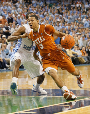 GREENSBORO, NC - DECEMBER 18:  Cory Joseph #5 of the Texas Longhorns drives around Dexter Strickland #1 of the North Carolina Tar Heels at Greensboro Coliseum on December 18, 2010 in Greensboro, North Carolina.  (Photo by Kevin C. Cox/Getty Images)