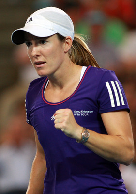 PERTH, AUSTRALIA - JANUARY 08:  Justine Henin of Belgium celebrates winning the first set during her singles match against Bethanie Mattek-Sands of the USA on day eight of the Hopman Cup on January 8, 2011 in Perth, Australia.  (Photo by Paul Kane/Getty I
