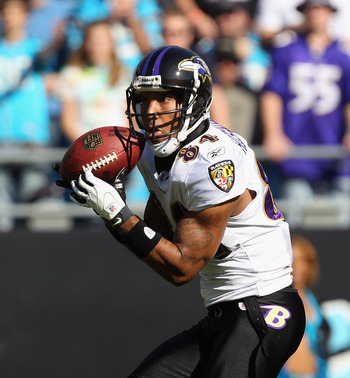 CHARLOTTE, NC - NOVEMBER 21:  T.J. Houshmandzadeh #84 of the Baltimore Ravens against the Carolina Panthers at Bank of America Stadium on November 21, 2010 in Charlotte, North Carolina.  (Photo by Streeter Lecka/Getty Images)