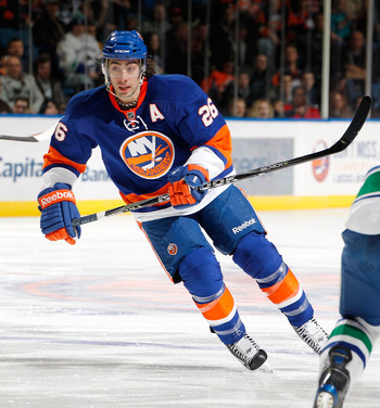 UNIONDALE, NY - JANUARY 11:  Matt Moulson #26 of the New York Islanders skates during an NHL game against the Vancouver Canucks at the Nassau Coliseum on January 11, 2011 in Uniondale, New York.  (Photo by Paul Bereswill/Getty Images)