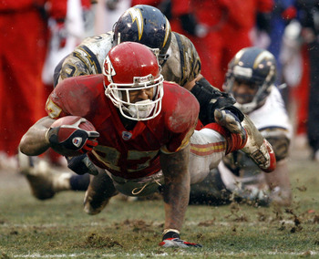 KANSAS CITY, MO - DECEMBER 24:  Larry Johnson #27 of the Kansas City Chiefs is tackled by Luis Castillo #93 of the San Diego Chargers in the fourth quarter on December 24, 2005 at Arrowhead Stadium in Kansas City, Missouri. Kansas City Chiefs won 20-7 ove