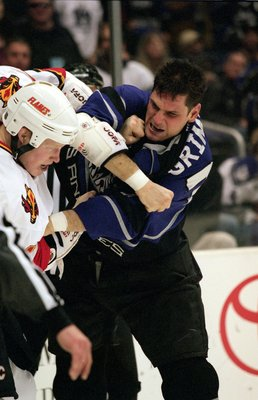 6 Jan 2001:  Stu Grimson #32 of the Los Angeles Kings fights with Wade Belak #4 of the Calgary Flames during the game at the STAPLES Center in Los Angeles, California. The Kings defeated the Flames 5-0.Mandatory Credit: Kellie Landis  /Allsport