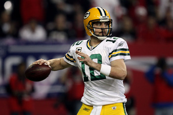 ATLANTA, GA - JANUARY 15:  Aaron Rodgers #12 of the Green Bay Packers throws a pass against the Atlanta Falcons during their 2011 NFC divisional playoff game at Georgia Dome on January 15, 2011 in Atlanta, Georgia.  (Photo by Streeter Lecka/Getty Images)
